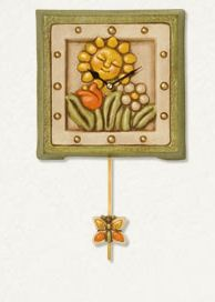 Orologio da parete thun pendola con sole e fiori the for Orologio pendolo thun