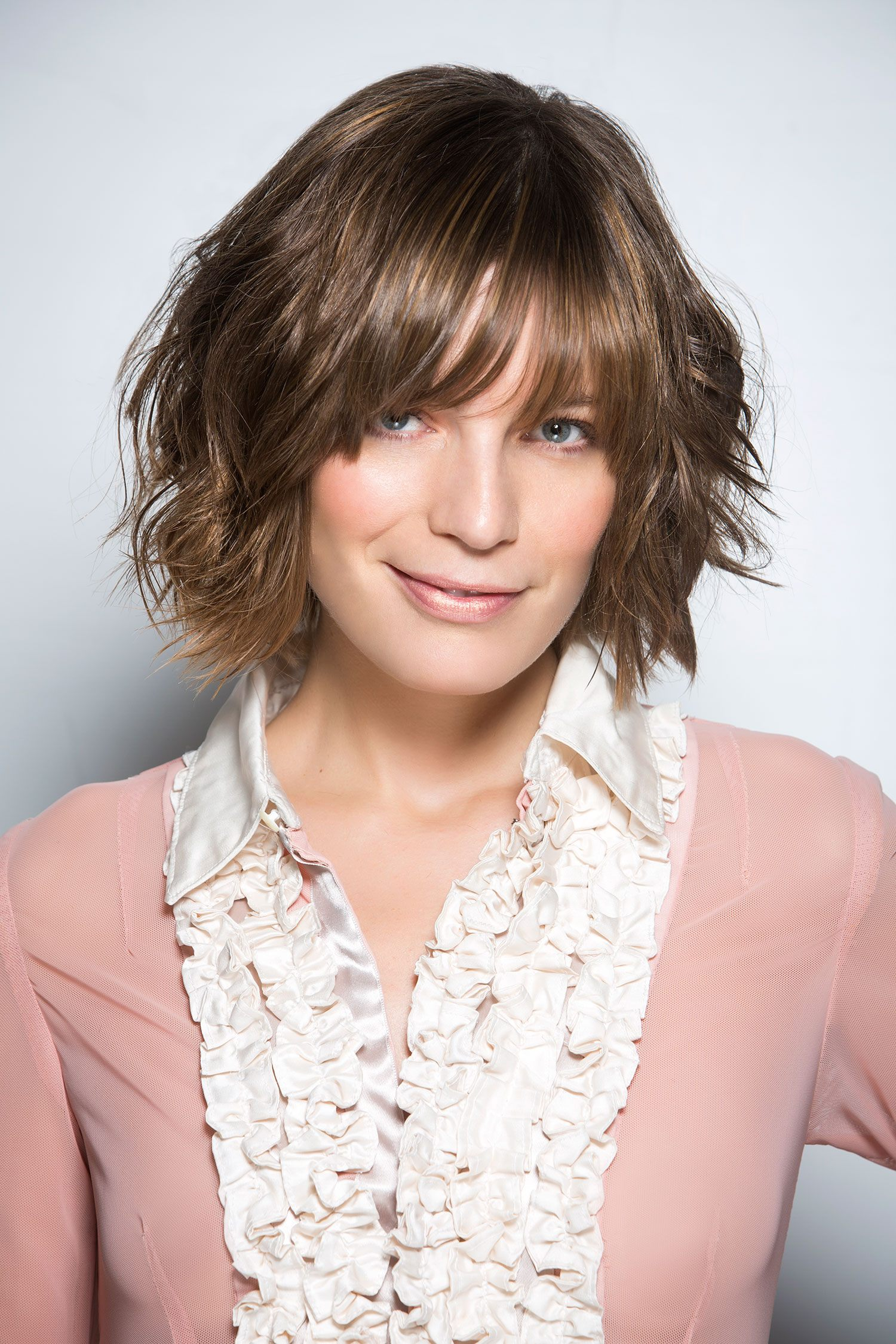 Tagli capelli corti femminili con frangia