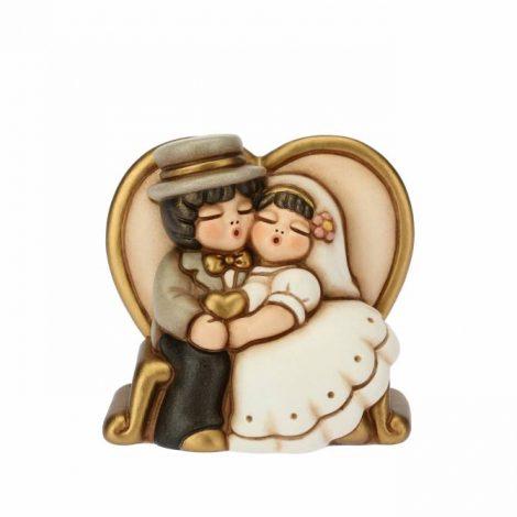 Idea Bomboniera Matrimonio THUN sposini seduti su una panchina a forma di cuore
